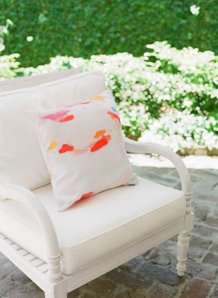Watercolored pillows dressed lounge chairs.
