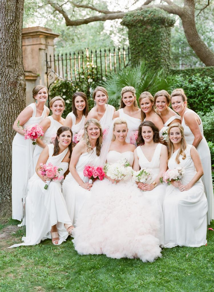 Cate's blush-hued gown paired with her bridesmaids' ivory dresses (the bride and her attendants all wore Monique Lhuillier) and their mix-and-match blooms made for a pink and white ombré effect.