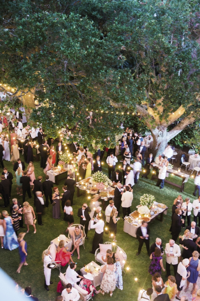 Low-reaching live oak tree limbs meant Tara's team couldn't tent the entire garden but luckily the weather held, so the only thing between guests and the wide open sky were the twinkling lights that mingled with branches. Photograph by Corbin Gurkin.