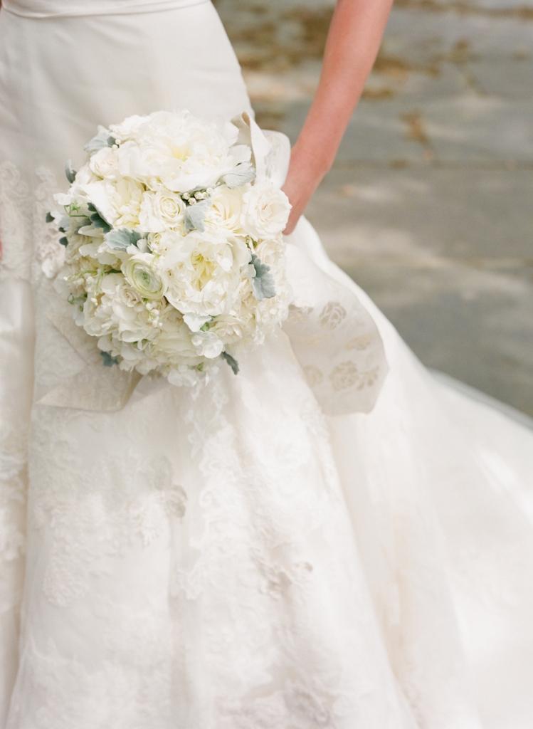 Photograph by Corbin Gurkin. Bride's attire by Vera Wang. Bouqet by Tara Guerard Soiree.