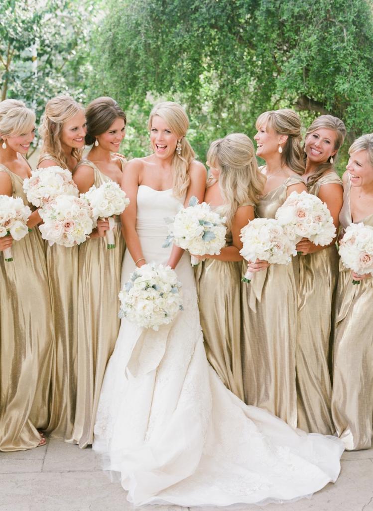 Photograph by Corbin Gurkin. Bride's attire by Vera Wang. Bridesmaids' attire by Kate McDonald, available in Charleston through Kate McDonald Bridal. Bouqets by Tara Guerard Soiree.