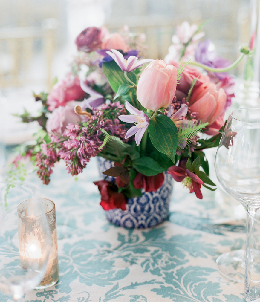 """Laura presented Tara with a trio of buzzwords: """"elegant,"""" """"intimate,"""" and """"romantic."""" Here, gardenia, orchids,  peonies, and roses ticked all three boxes. (Photo by Corbin Gurkin)"""