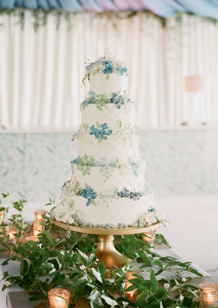 Cake maestro Jim Smeal works almost exclusively in buttercream, but he handmade  hundreds of sugar-paste flowers for Laura and Skip's stunning treat. (Photo by Corbin Gurkin)