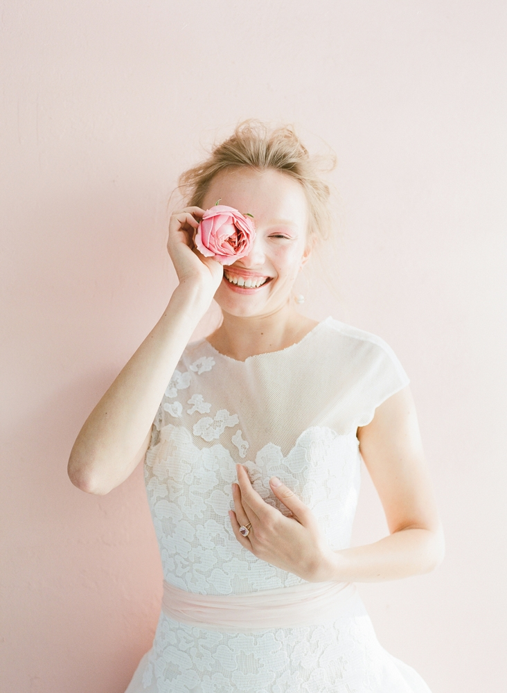 "Peter Langner's ""Waking Up"" silk organza and guipure lace ball gown from Betty Bridal Atelier. Mizuki's pearl and gold earrings from Croghan's Jewel Box. Jeffrey Campbell's ""Bitsie"" suede pumps in dark coral from Shoes on King. <i>Photograph by Corbin Gurkin</i>"