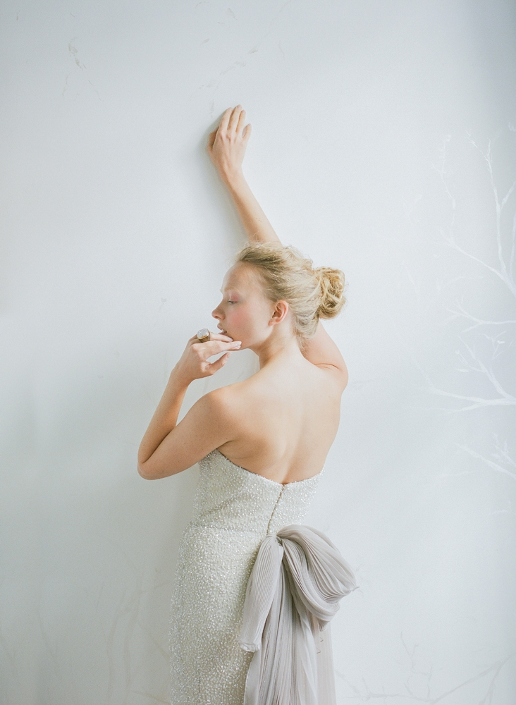 "Carol Hannah's ""Alyxia"" sequined gown with pleated organza bowed train in wisteria from Southern Protocol Bridal. Claudia Labao's white druzy and wood ring from Out of Hand. <i>Photograph by Corbin Gurkin</i>"