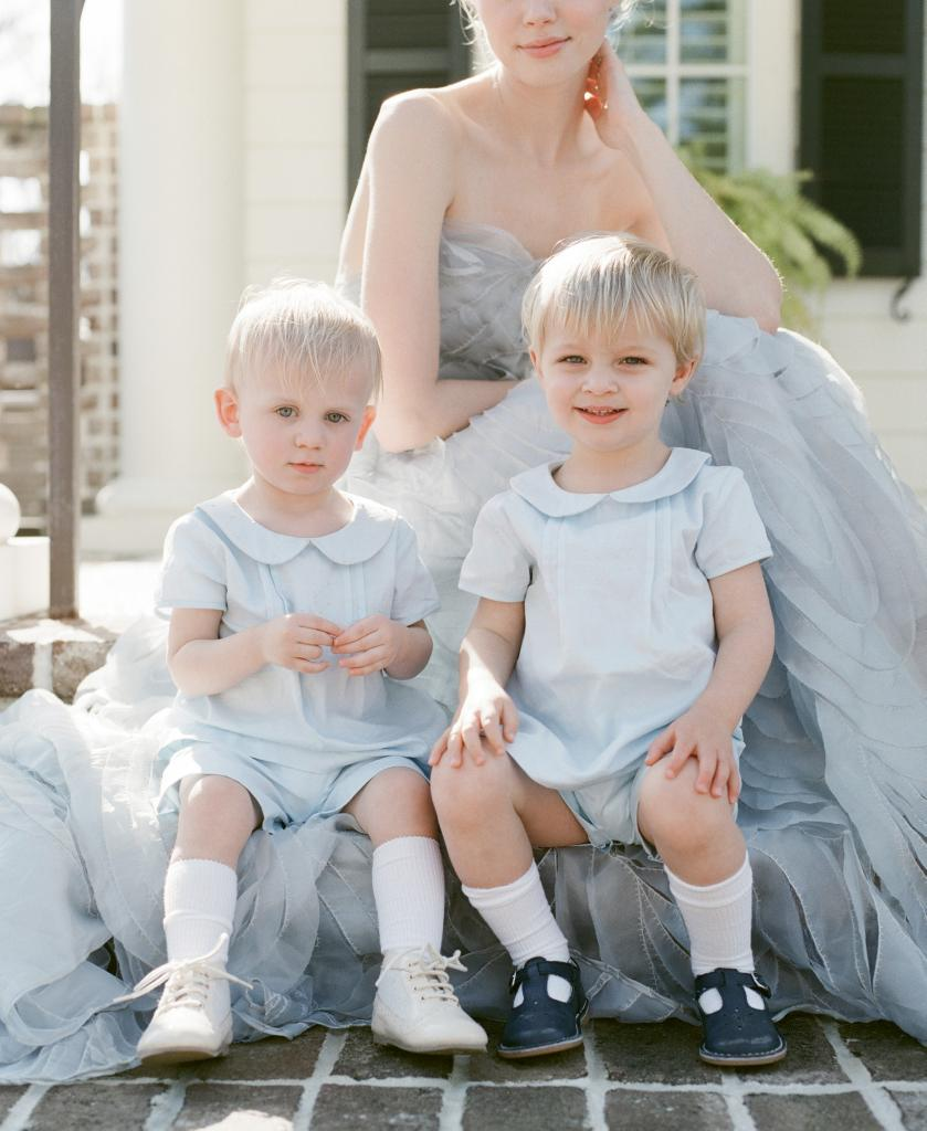 """On boys: Leda Jackson's blue cotton pique """"Vintage Apron and Shorts"""" from Pixie Lily. Boys' own shoes."""
