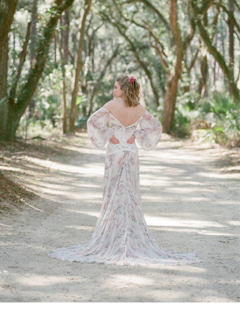 """Rue de Seine's printed crinkle silk """"Nahla"""" gown with ribbon details from Lovely Bride. Rose gold and morganite ring from Gold Creations."""