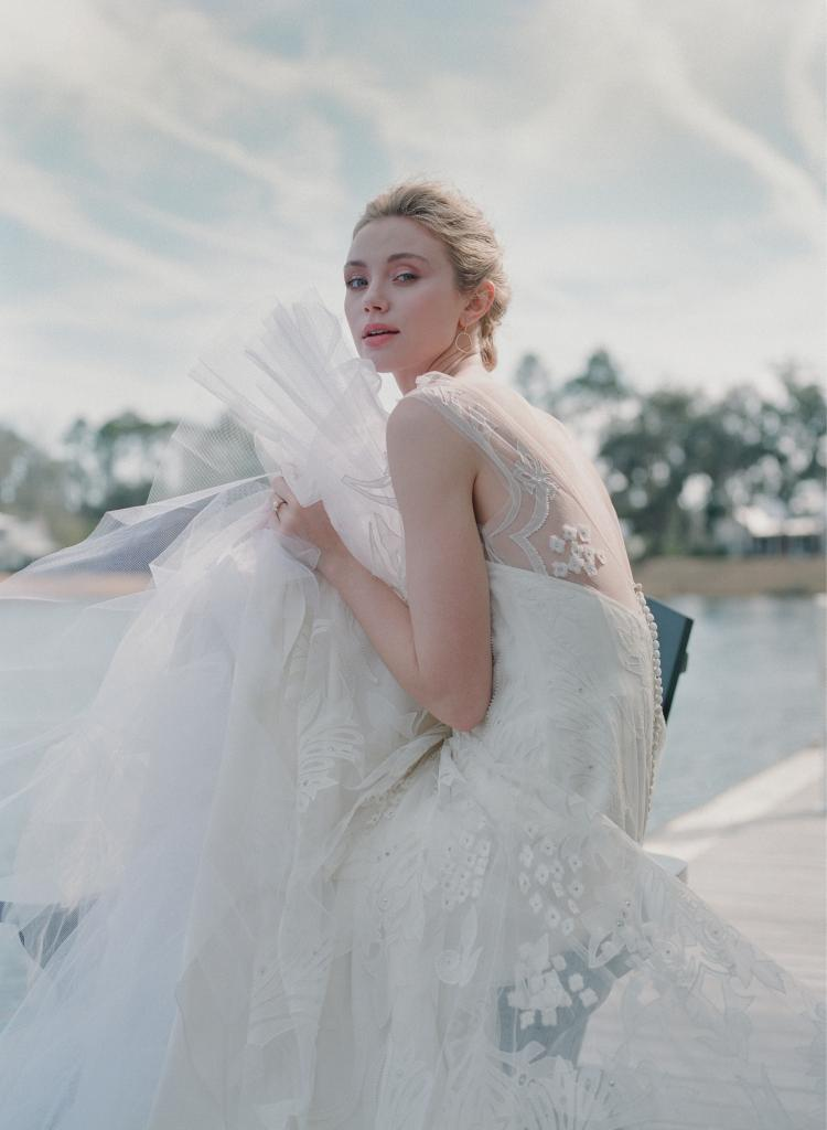 """Lela Rose's silk tulle """"The Central Park"""" gown with appliqués from Magnolia Bride Charleston. Gold and diamond earrings from Croghan's Jewel Box. Ruth Tomlinson's pearl and diamond ring from RTW."""