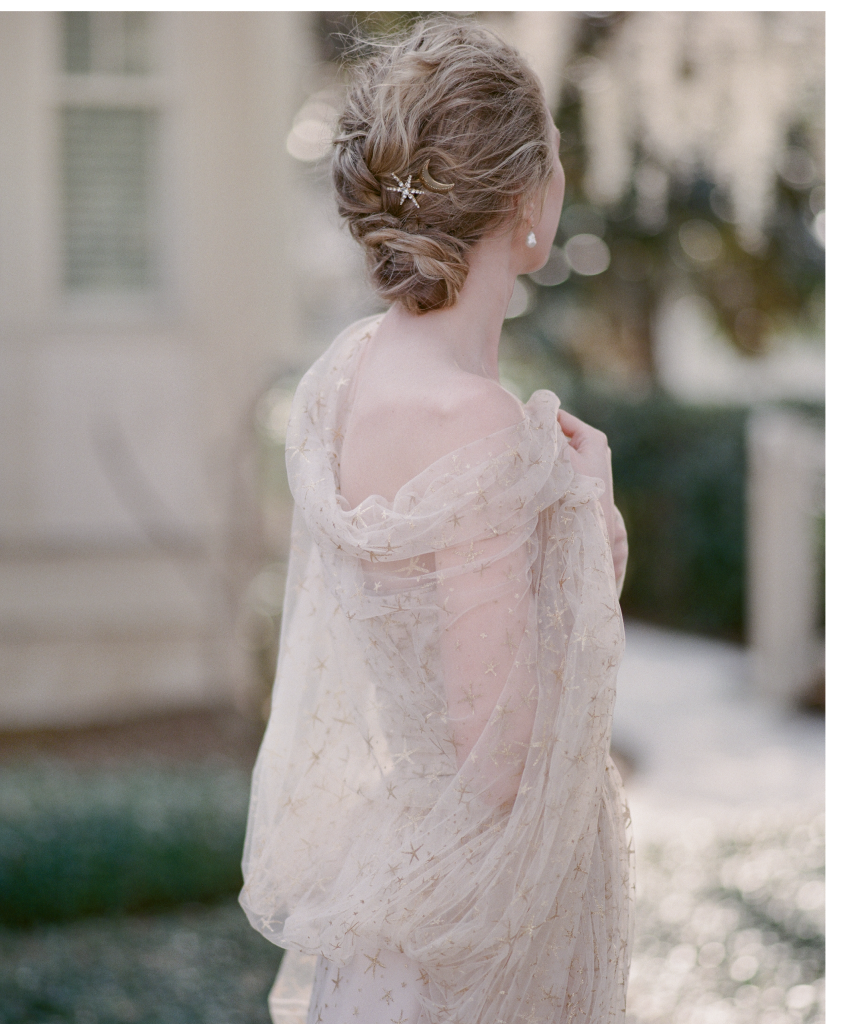 """Joanna August's tulle """"Brenda"""" gown with stars from Bella Bridesmaids. Ted Muehling's pearl earrings from RTW.  Jennifer Behr's """"Estelle"""" star hairpin from Gwynn's of Mount Pleasant. Marisa Mason's crescent moon hairpin from Out of Hand."""