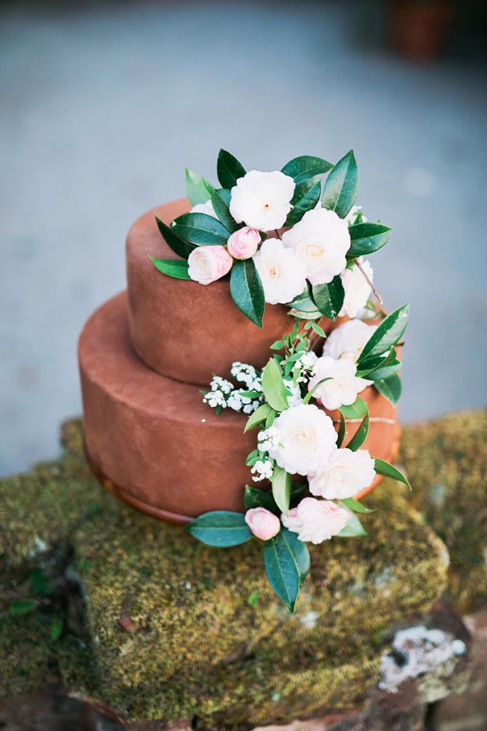 Look to your surroundings for floral cake accents. For this cocoa-dusted treat, fresh, in-season camellias paid tribute to those on Middleton's grounds, where the shrub first thrived outdoors in America.