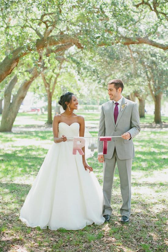 PICTURE-PERFECT PAIR: Holding their handcrafted signature insignia, Ruth and Thomas give off that newlywed glow.