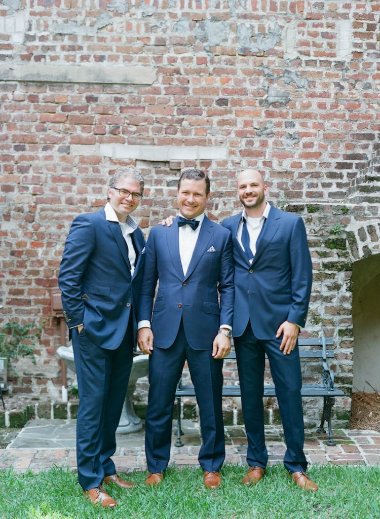 Groom's suit by Michael Andrews, tie from The Tie Bar, and shoes by Cole Haan. Groomsmen's suits from My.Suit, tie from The Tie Bar, and shoes by Cole Haan. Photograph by Elizabeth Messina at the French Huguenot Church of Charleston.
