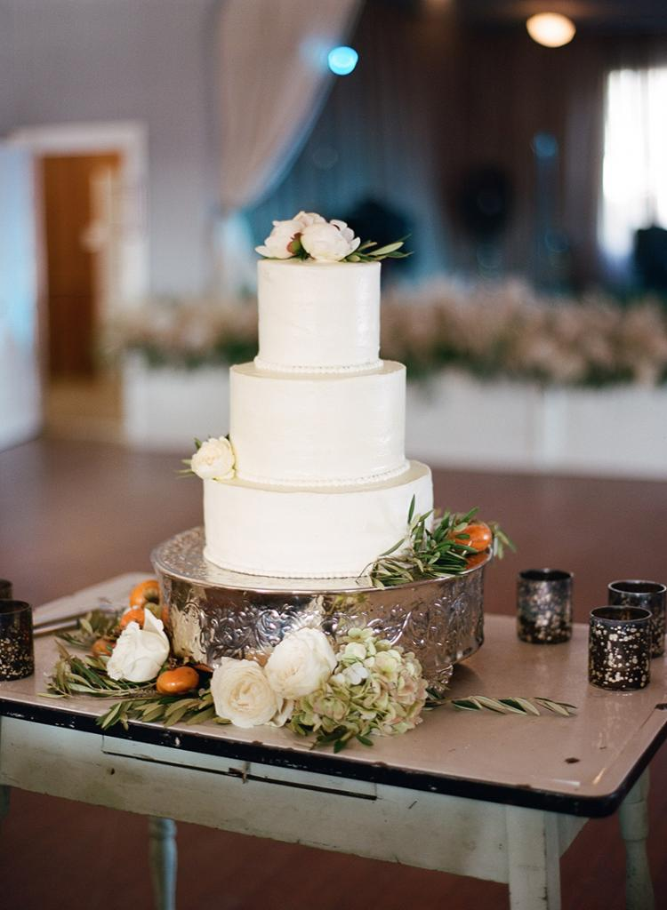 """""""Persimmons are a great autumn option that you can order on the branch,"""" says florist Anne Bowen of Charleston Stems. """"The few surrounding the cake were the rebellious ones who preferred to participate in the wedding off the branch."""" Christen Reese of Chocolate Cake—a go-to for townies looking for special occasion treats that are utterly, divinely homemade—stepped out of the cocoa realm for this three-tiered confection."""