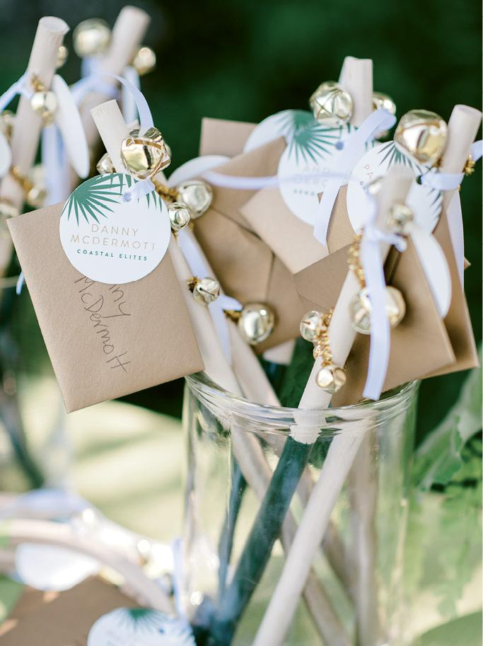 Guests found seat assignments (with handwritten notes from the couple) tied to bell wands and tambourines that they shook as a band led everyone from the cocktail hour to the reception. The second line was a nod to both couple's family ties to New Orleans.