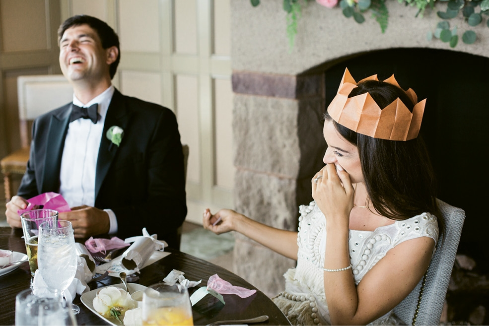 Brooke's mom carried on her party tradition of sharing paper crowns and poppers, and customized the latter with rhyming riddles about the newlyweds.