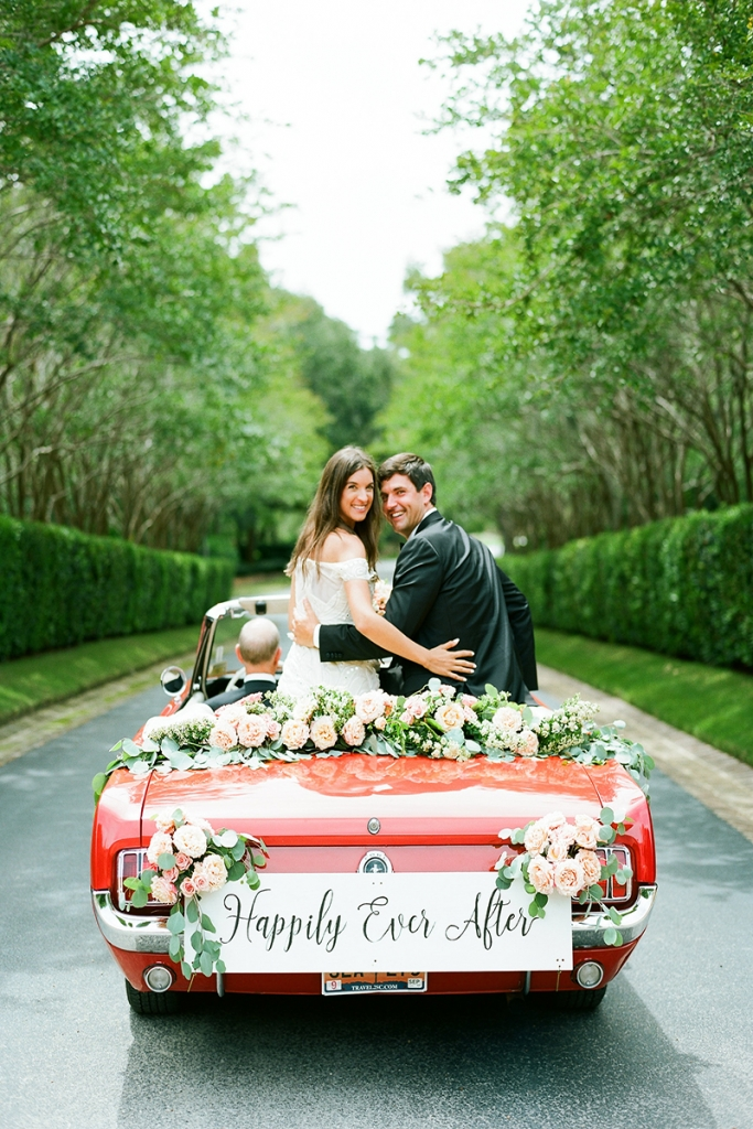 "The couple left the reception in the father of the bride's 1965 Ford Mustang convertible. Brooke's mother penned the ""Happily Ever After"" sign, which now hangs in the newlywed's bedroom."