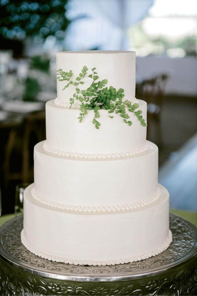 In the same vein as the bride's clean-lined, classic white column wedding gown, their wedding cake was the epitome of understated elegance.