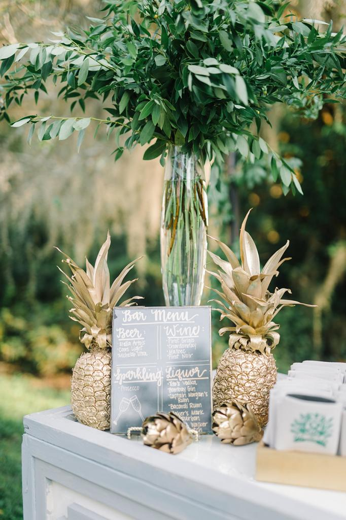 Spray pineapples (a symbol of Charleston hospitality) gold for an inexpensive décor element.