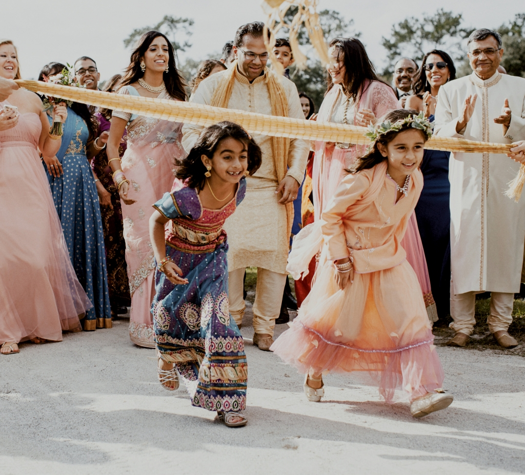 """The baraat is a huge party before the ceremony,"" says bride Jennifer Deitz who exchanged vows with Agam Jain at Middleton Place in an Indian fusion wedding. ""Everyone gets pumped and excited."""