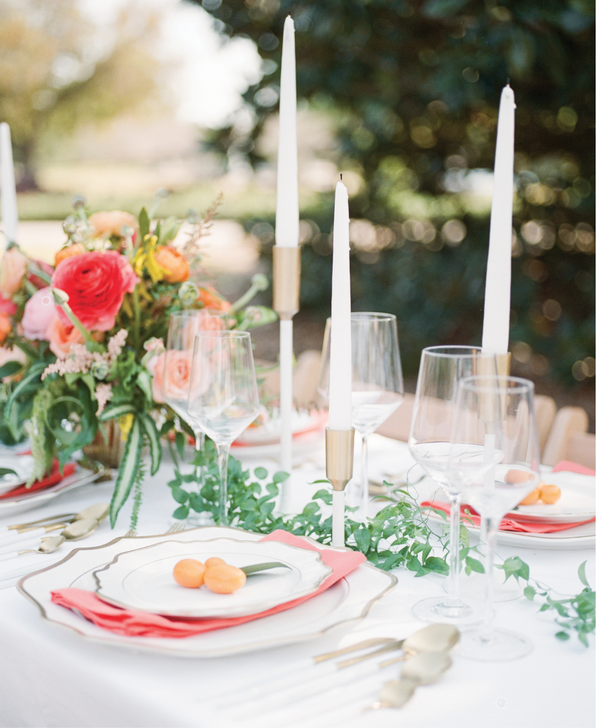 Stay Fresh - If you're marrying in the height of summer, choose heartier organics like ranunculus (used in the bouquet and on tables), vines like smilax (seen here as a table runner), and citrus fruits like kumquats, lemons, and oranges to ensure they hold up in soaring temps.     <i>Photography Alex Thorton</i>