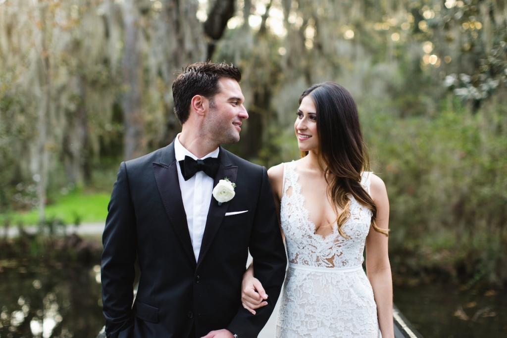 Menswear by Dolce & Gabbana. Bride's gown by Inbal Dror. Hair by Swish. Makeup by Ooh! Beautiful. Image by Clay Austin Photography at Magnolia Plantation & Gardens.