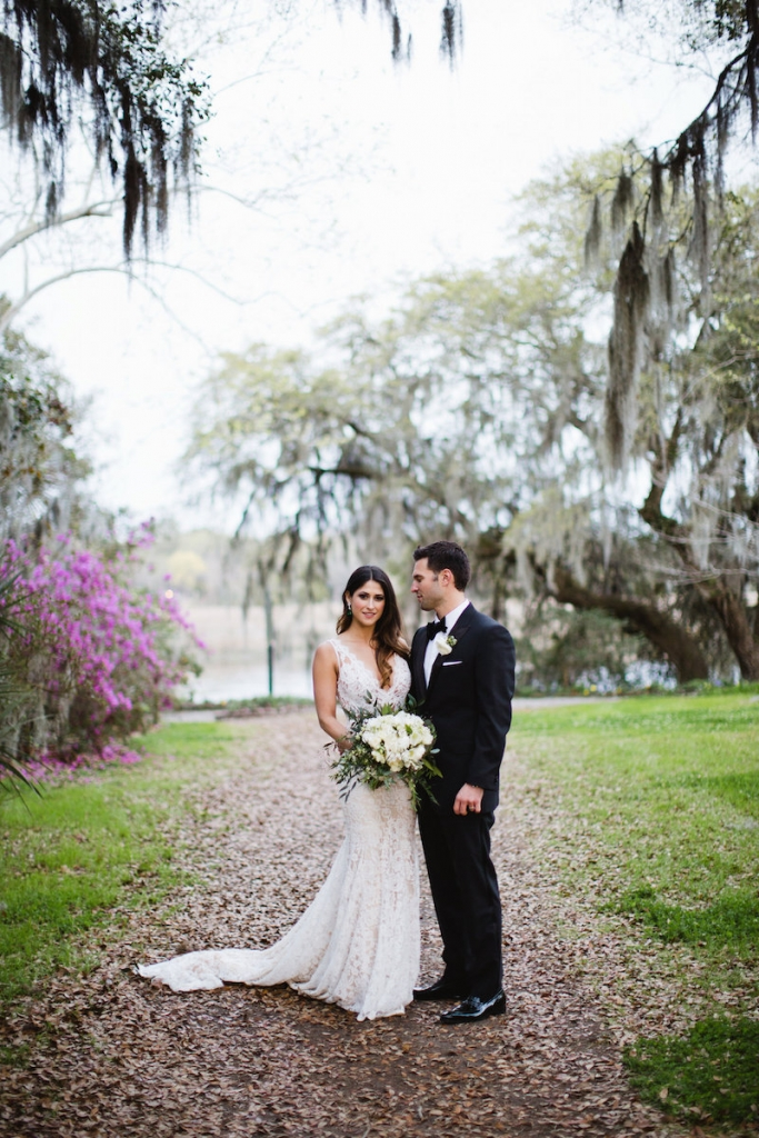 Menswear by Dolce & Gabbana. Bride's gown by Inbal Dror. Florals by Out of the Garden. Image by Clay Austin Photography at Magnolia Plantation & Gardens.