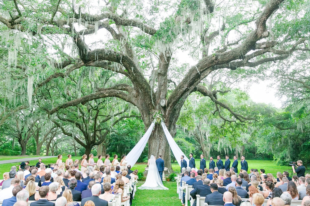 Andra liked the idea of marrying in a church but recognized the logistical benefits of hosting both ceremony and reception at one place, so Stacey fashioned an alfresco chapel of sorts using pews from Snyder Events.