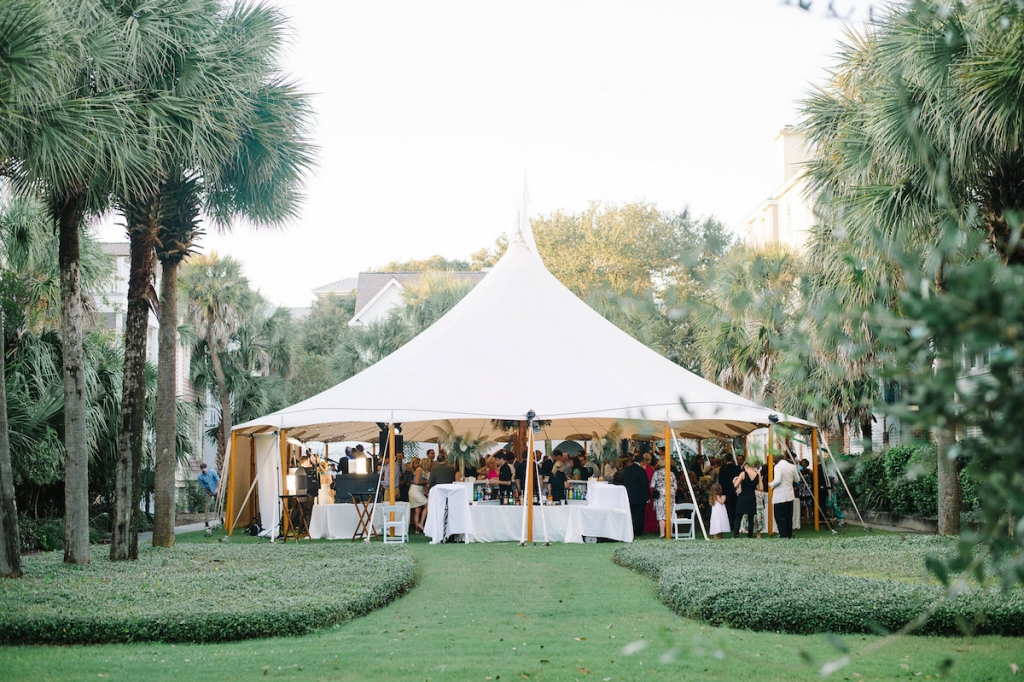 Wedding design by Sweetgrass Social. Tent by Sperry Tents Southeast. Image by Aaron and Jillian Photography at Wild Dunes Resort.