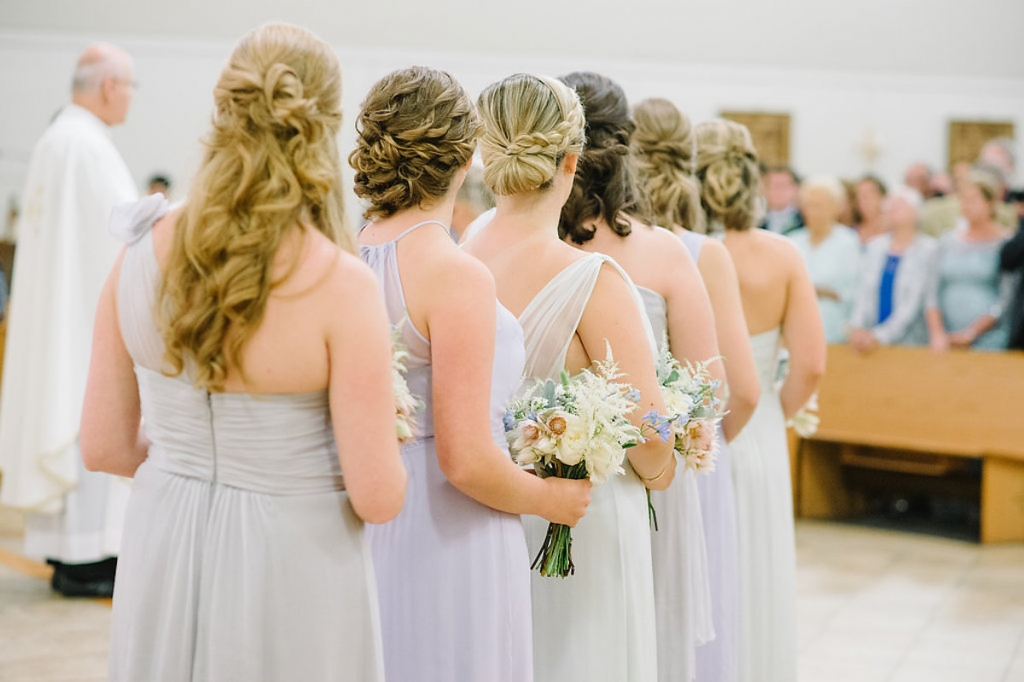 Bridesmaid gowns by Amsale from Bella Bridesmaids. Image by Aaron and Jillian Photography at St. Benedict's Roman Catholic Church.