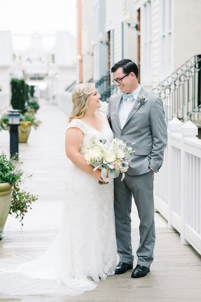 Bride's gown by Maggie Sottero, available in Charleston through Bridals by Jodi. Hair and makeup by Paper Dolls. Groom's tux from The Black Tux. Bow tie from M. Dumas & Sons. Florals by Branch Design Studio. Image by Aaron and Jillian Photography at Wild Dunes Resort.