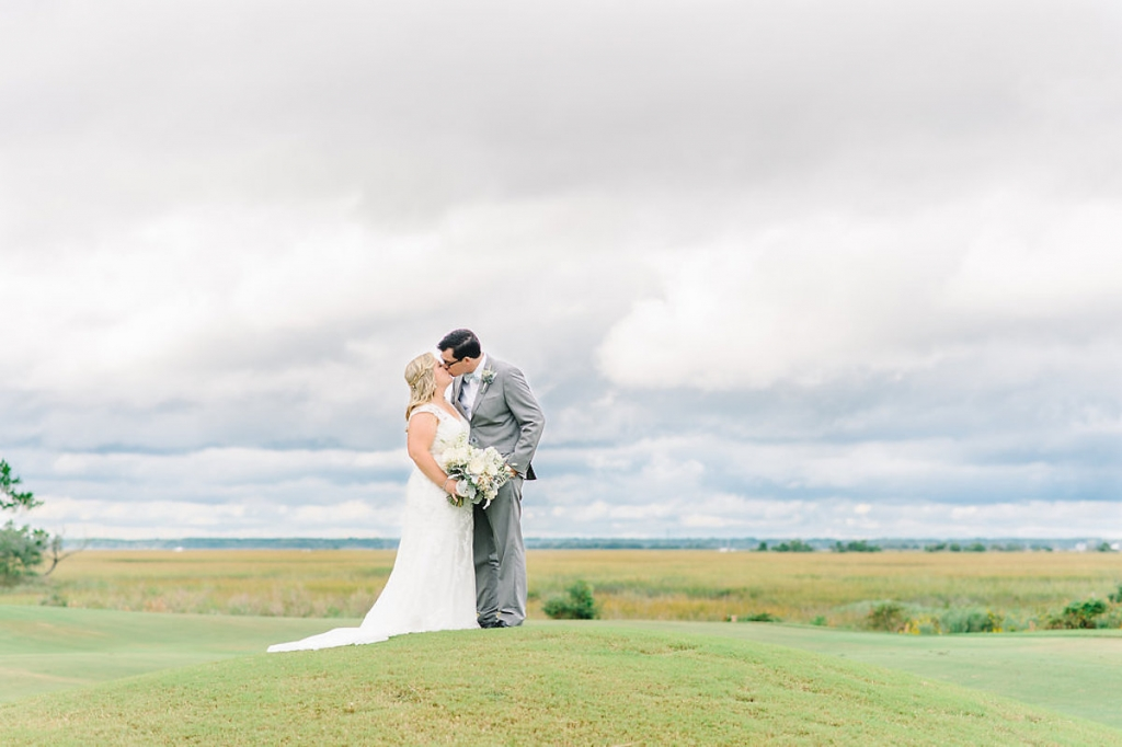 Bride's gown by Maggie Sottero, available in Charleston through Bridals by Jodi. Groom's tux from The Black Tux. Image by Aaron and Jillian Photography at Wild Dunes Resort.