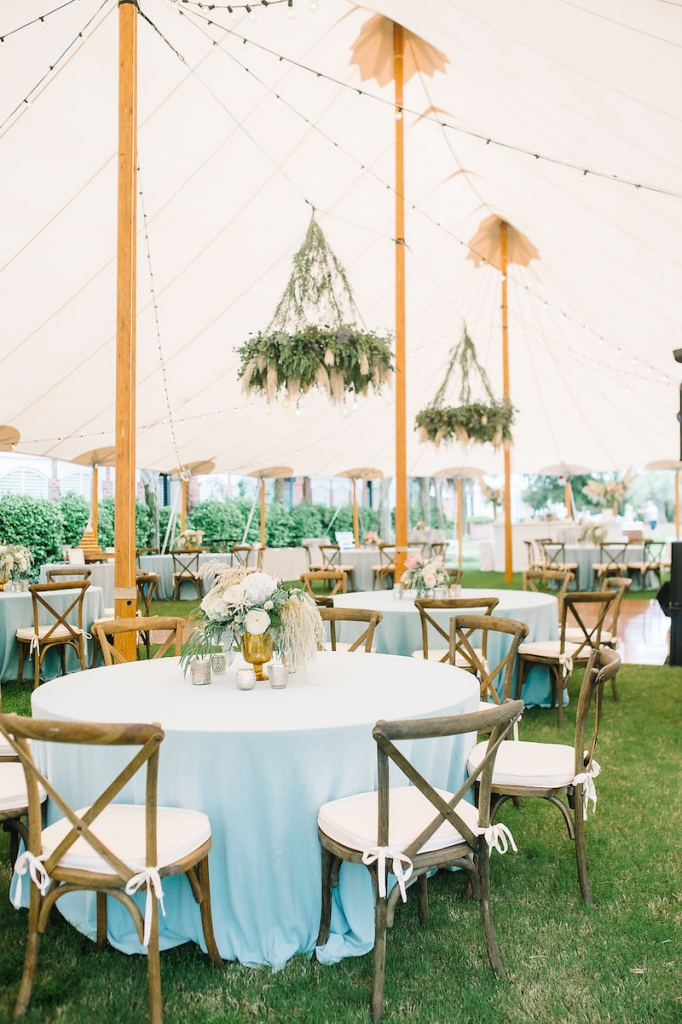 Wedding design by Sweetgrass Social. Florals by Branch Design Studio. Rentals from EventWorks. Tent from Sperry Tents Southeast. Linens from La Tavola. Image by Aaron and Jillian Photography at Wild Dunes Resort.