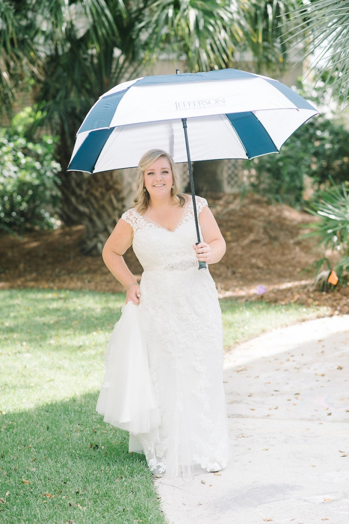 Bride's gown by Maggie Sottero, available in Charleston through Bridals by Jodi. Hair and makeup by Paper Dolls. Image by Aaron and Jillian Photography.
