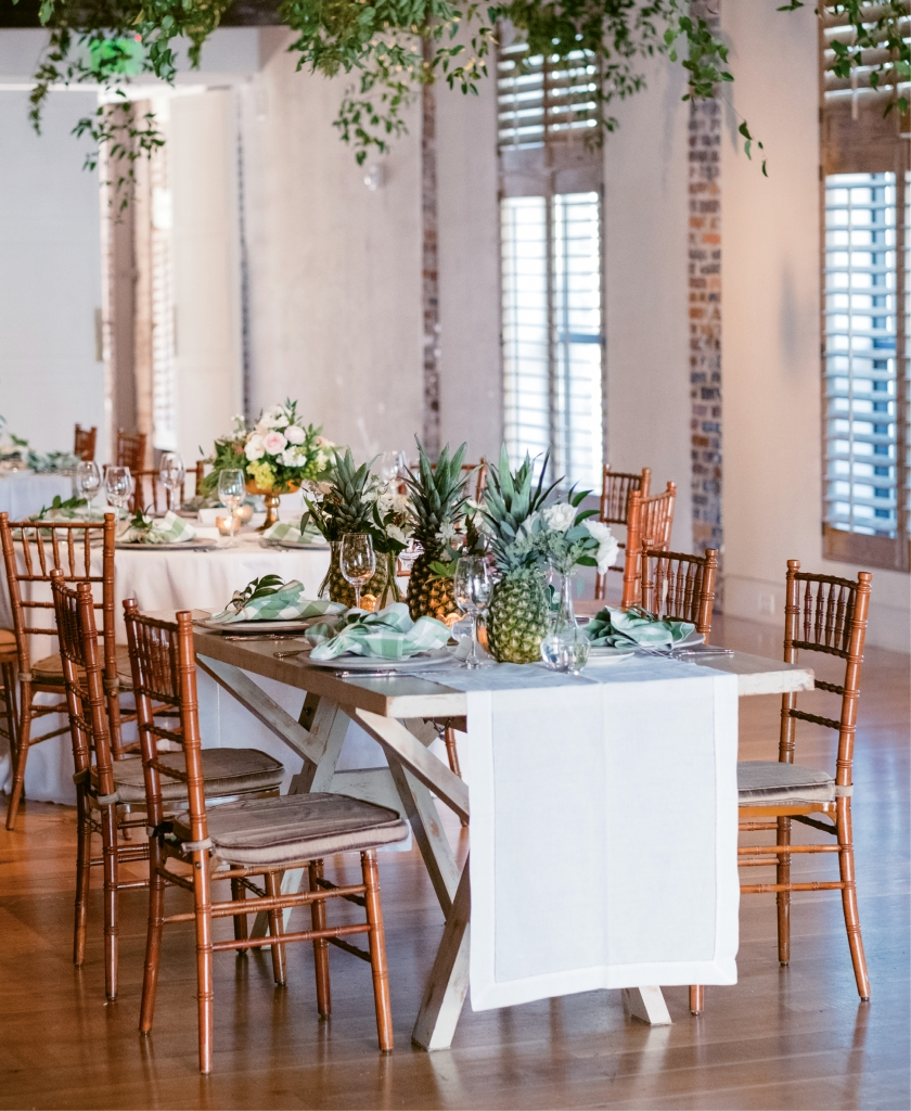 Nice Thinking! - In addition to the florals decorating tabletops, greenery and twinkling lights were woven into the eaves above. Overhead installations like these soften a setting without the expense of custom lighting or draped fabric.
