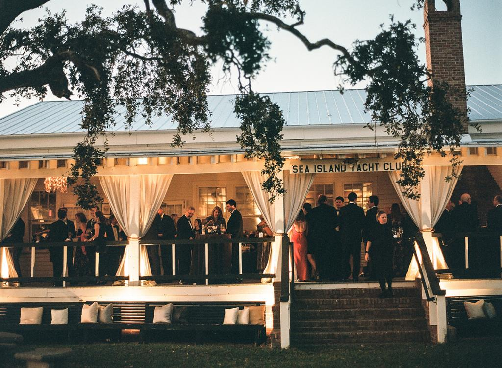 A full moon cast a soft, soothing glow on the porch of the club, where the bride has spent many weekends, shucking oysters and gazing at the boats that pile in for the annual Rockville Regatta.