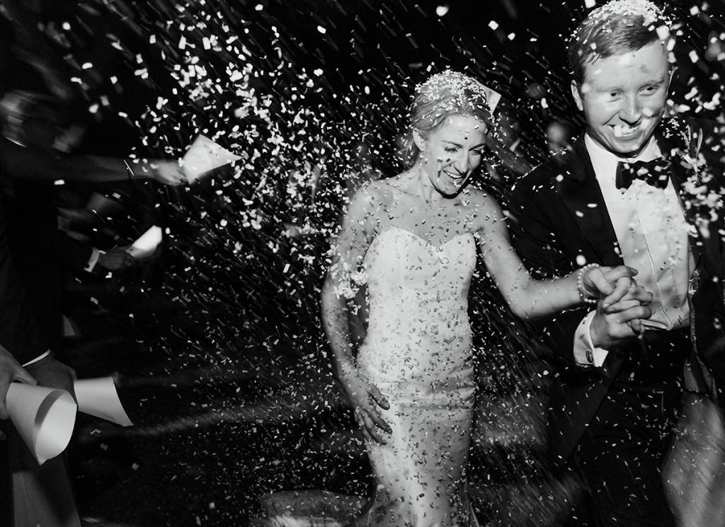 """White, biodegradable """"Ecofetti"""" rained down on the newlyweds before they headed off to their honeymoon in Costa Rica."""