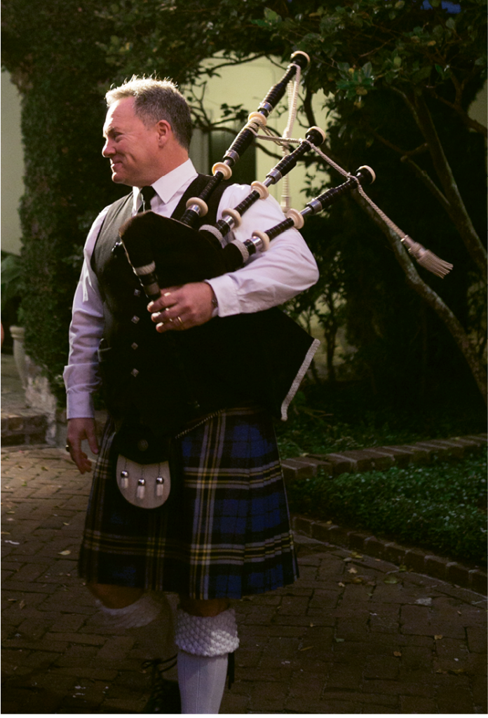 A bagpiper played throughout the ceremony and as the couple walked into their reception.