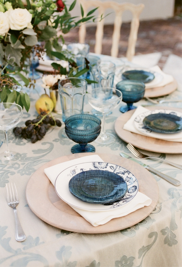"""With blue on everything from the printed materials to the lounge pillows and linens,"" says planner Haley, ""having china and glassware in shades of blue was a must."""