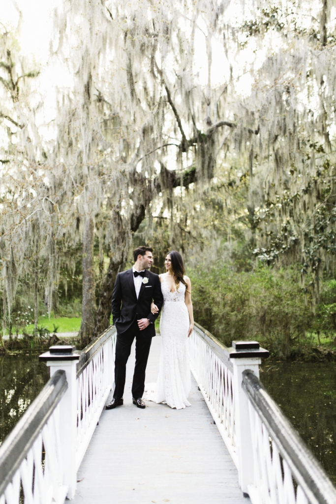 Menswear by Dolce & Gabbana. Bride's gown by Inbal Dror. Image by Clay Austin Photography at Magnolia Plantation & Gardens
