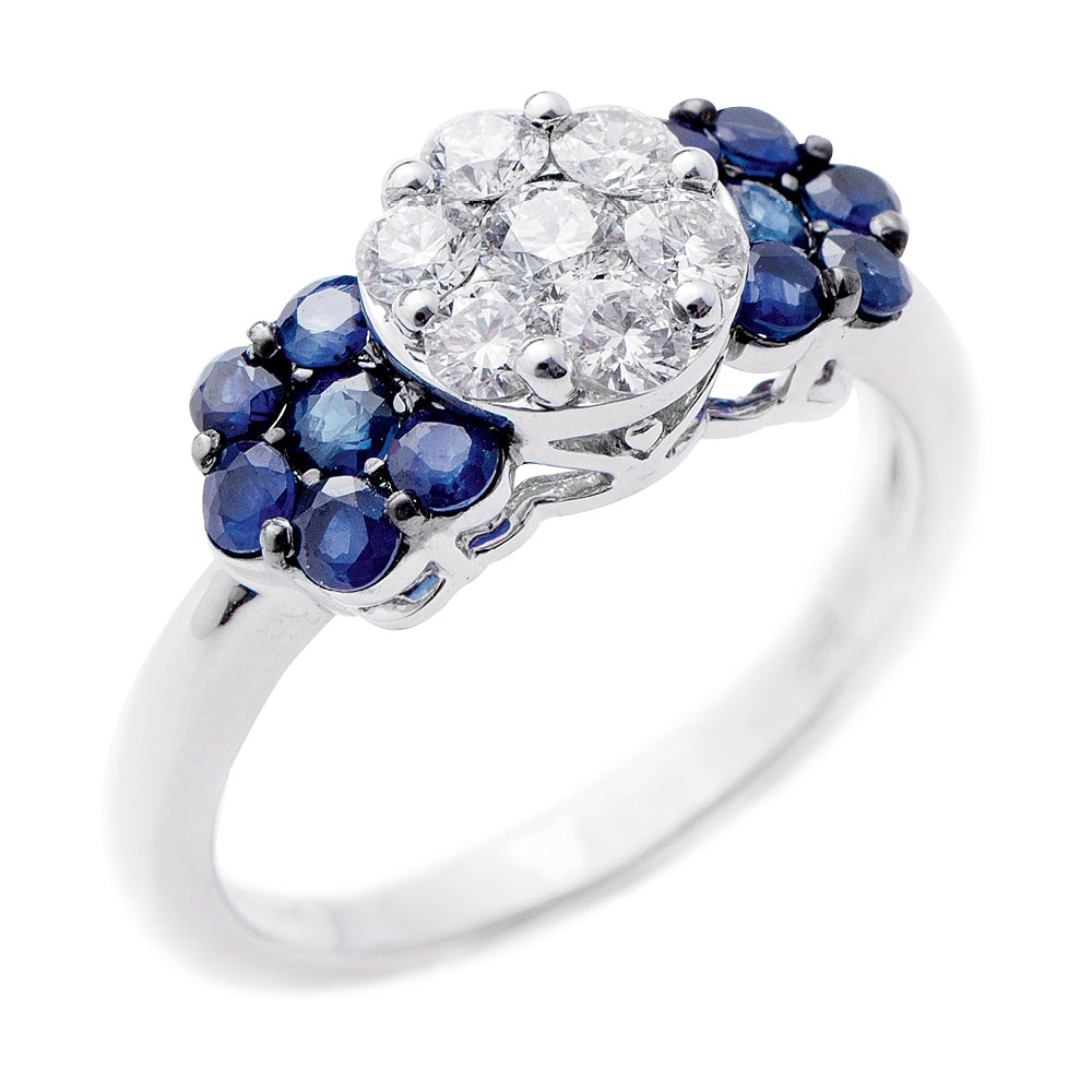 14K white gold ring with diamond cluster center (.5 total cts.) and sapphires (.75 total cts.), from REEDS Jewelers ($2,550)