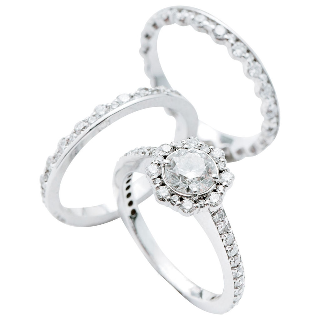 Forevermark Integré by  Pluczenik's 18K white gold bands with diamonds (1.3 total cts. each, $3,600 for pair) and ring with diamond center (.7 cts.) and accent diamonds (1.3 total cts., $5,720), all from Paulo Geiss Jewelers