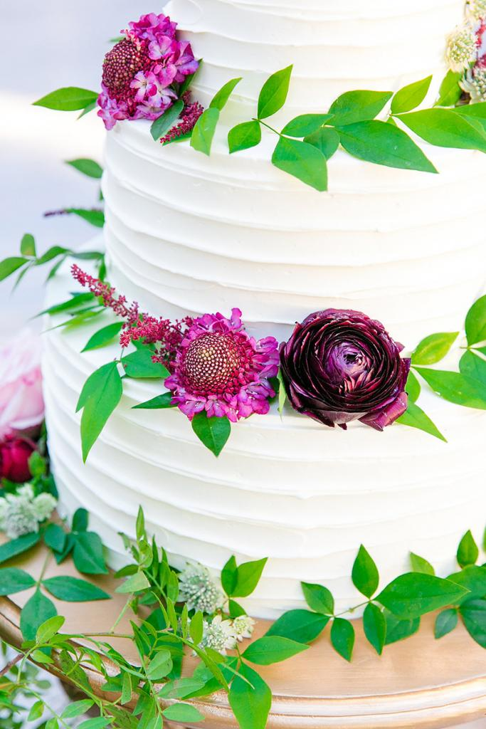 Showcase colorful details. Here, classic white cake proved the ideal backdrop for vivid blooms.