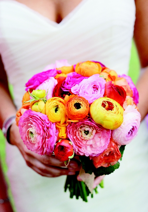 TO HAVE AND TO HOLD: Engaging Events' floral designer Judy Johnston fashioned a cheerful bridal bouquet using the bride's favorite flower, ranunculus, in a range of  hot colors from sunny yellow to fiery red.