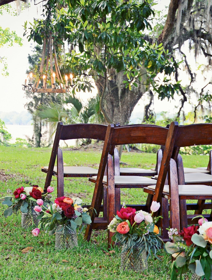 Guests looked upon the couple, grand  trees, and the  Ashley River. (Image by McKay Photography)