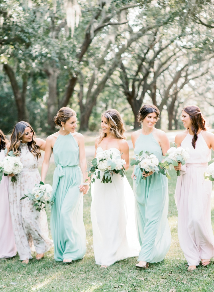 "After gleaning inspiration from  Pinterest, Dani knew she wanted her attendants to don gowns in different hues and prints. To keep the look streamlined, she chose one frock—""Alana"" from BHLDN—that was offered in a host of coordinating colors and patterns.   <i>Image Aaron & Jillian Photography</i>"