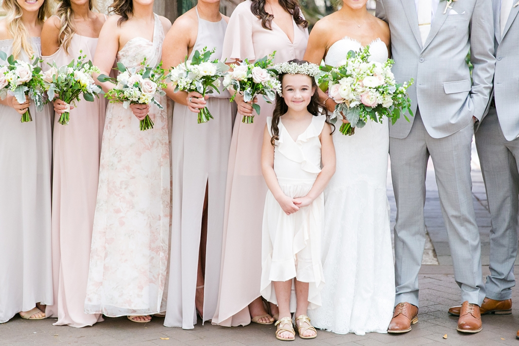 TIP: Let your flower girl shine. Elena's littlest wedding party member donned gold sandals (from Target).  Image by Dana Cubbage Weddings