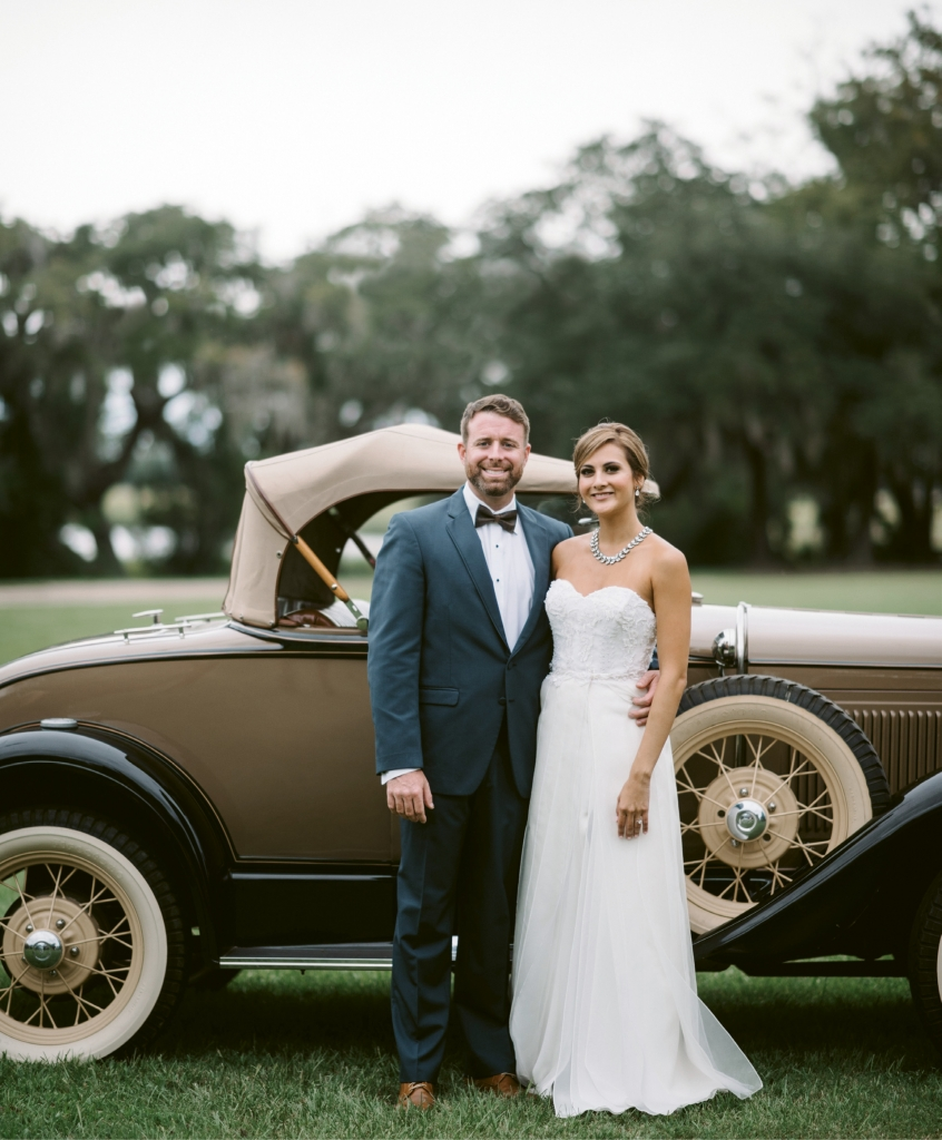 A focal point of the wedding—besides the newlyweds, of course—was the groom's dad's vintage car, which carried the couple around the plantation after their vows. (Photograph by Sean Money + Elizabeth Fay)