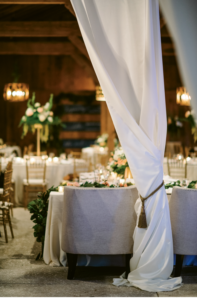 """Elizabeth wanted something beautiful and elegant but recognized that the reception was in a barn setting,"" says A Charleston Bride planner Lindsey Shanks. ""I love when a client understands not to 'fight the grain' of a space but opts to softly illuminate its features."" (Photograph by Sean Money + Elizabeth Fay)"