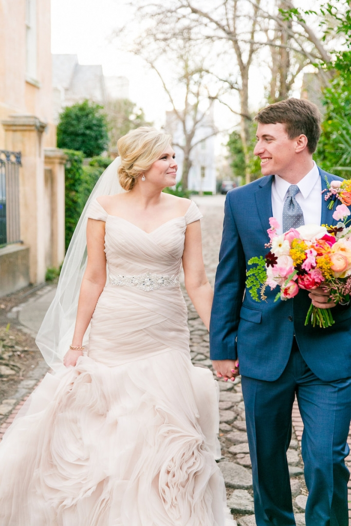 Florals by Branch Design Studio. Bride's gown by Essense of Australia from Gown Boutique of Charleston. Hair and makeup by Lashes and Lace. Groom's attire from Jos. A. Bank. Photograph by Dana Cubbage Weddings.