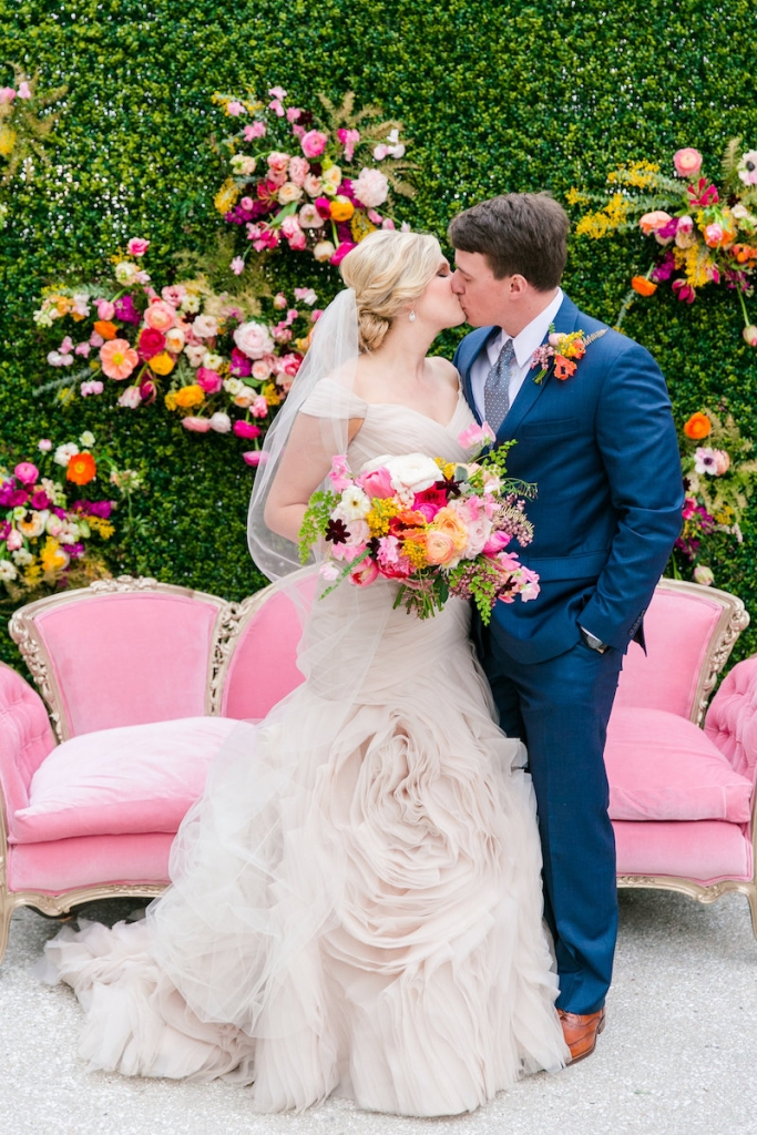 Florals by Branch Design Studio. Bride's gown by Essense of Australia from Gown Boutique of Charleston. Hair and makeup by Lashes and Lace. Groom's attire from Jos. A. Bank. Couch from 428 Main Vintage Rentals. Photograph by Dana Cubbage Weddings.